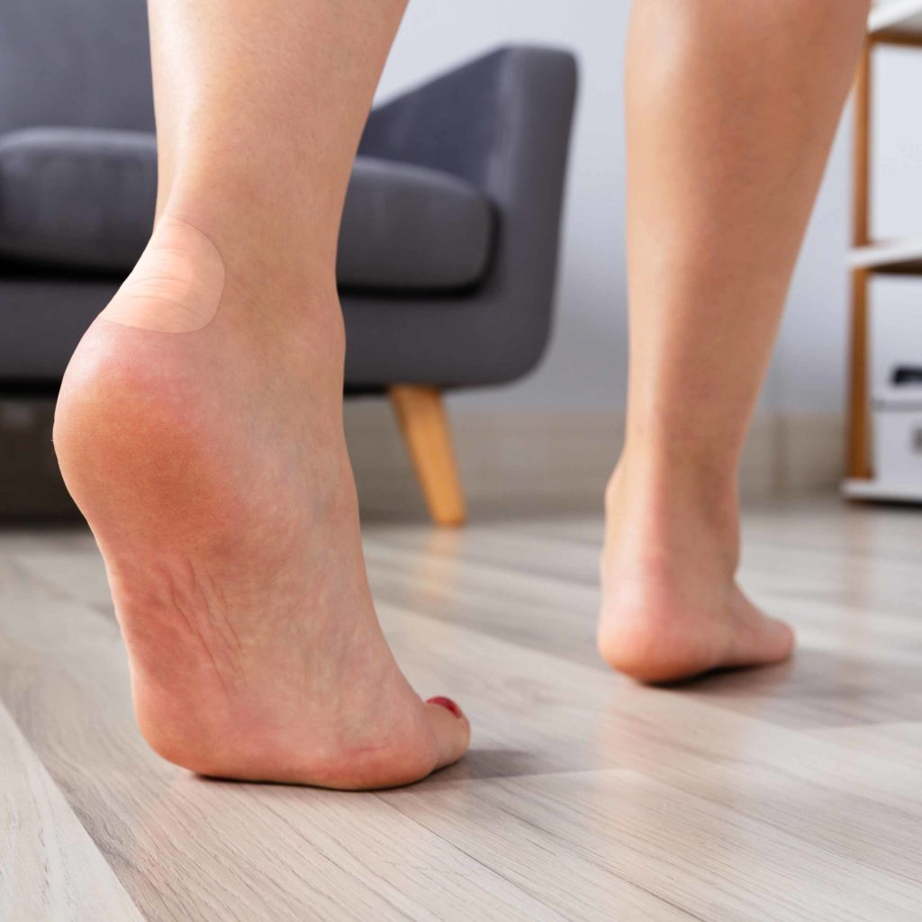 image of a dr scholls blister cushion on a bare foot heel