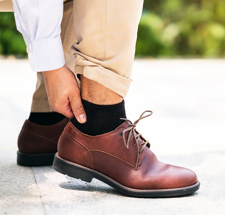 image of man holding his heel