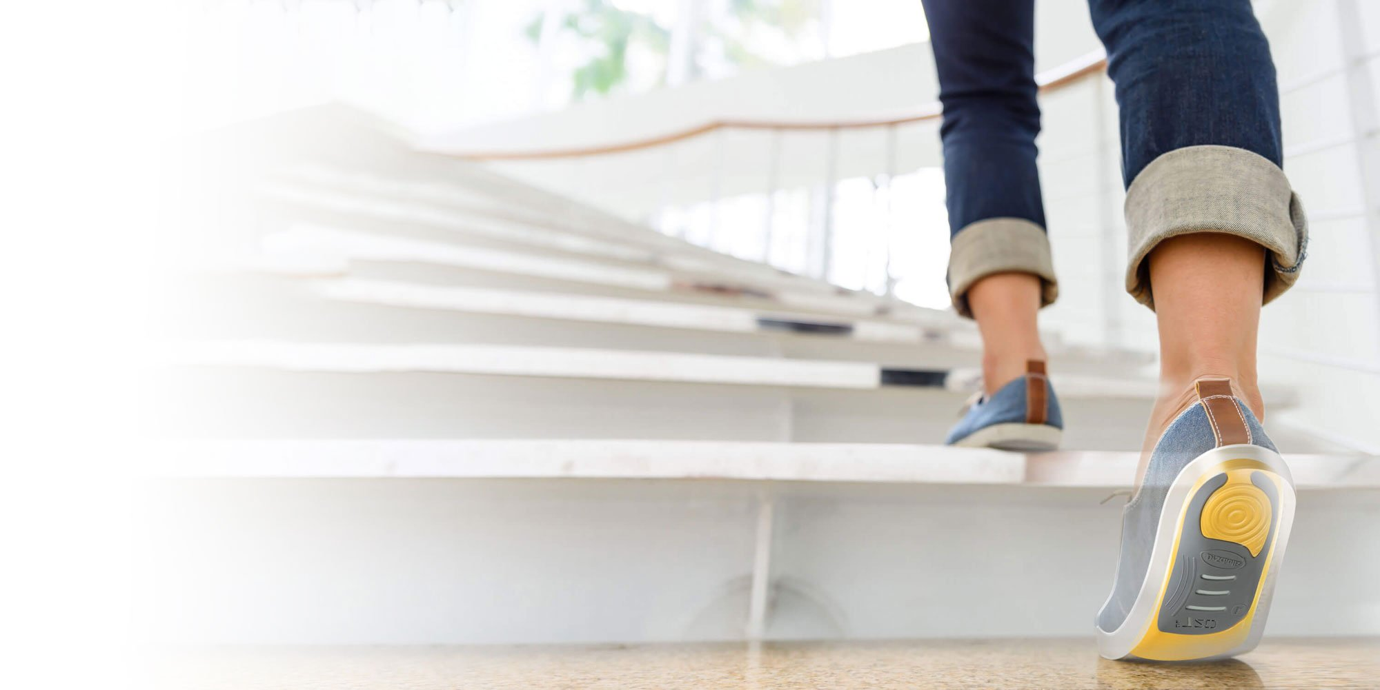 Image of person walking up stairs with Dr. Scholl's insoles in shoes