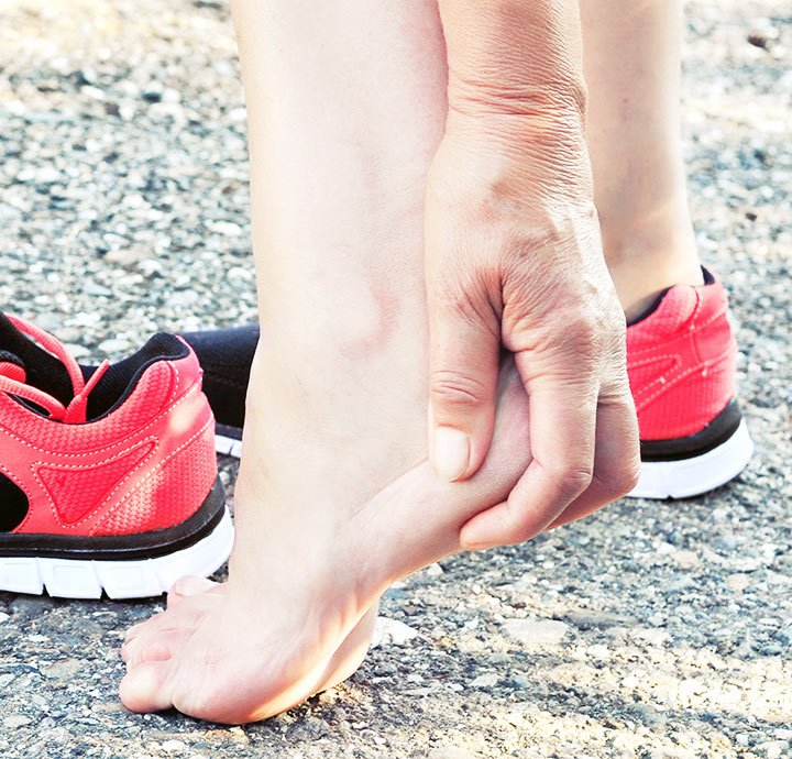 image of someone holding there heel