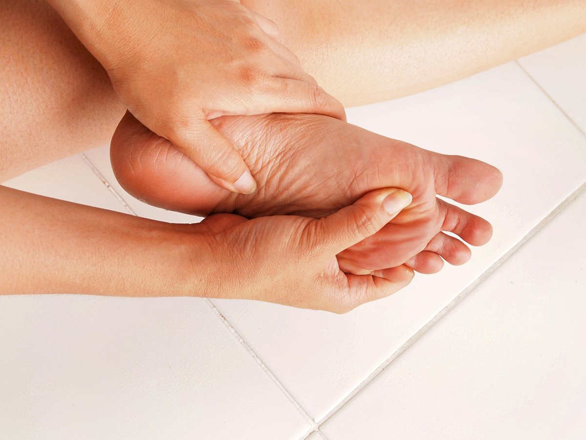 image of closeup shot of woman grabbing her feet