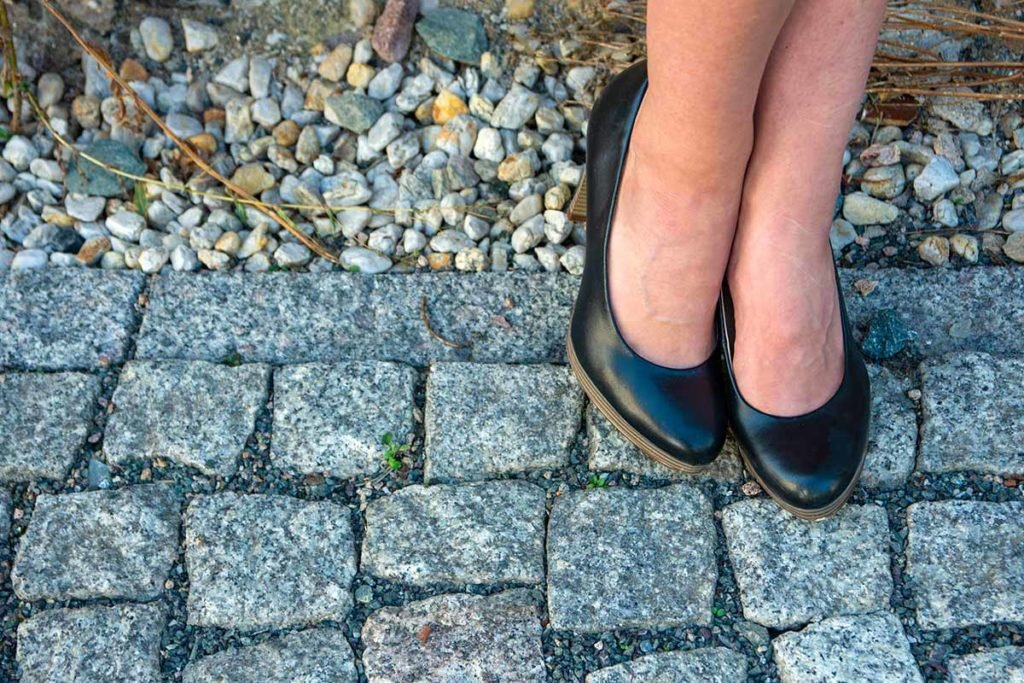 image of cobblestone streets and womens heels