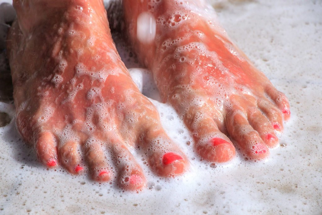 image of close up feet with soap